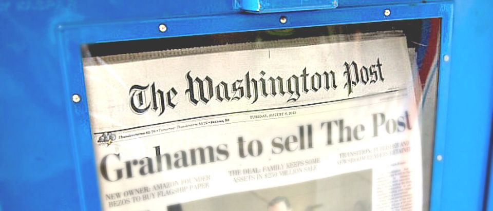 The front page of the Washington Post newspaper as seen in a newstand, August 6, 2013 in Washington, DC, the day after it was announced that Amazon.com founder and CEO Jeff Bezos had agreed to purchase the newspaper for USD 250 million from the Graham family. Multi-billionaire Bezos, who created Amazon, which has soared in a few years to a dominant position in online retailing, said he was buying the Post in his personal capacity and hoped to shepherd it through the evolution away from traditional newsprint. AFP PHOTO / Saul LOEB (Photo credit: SAUL LOEB/AFP/Getty Images)