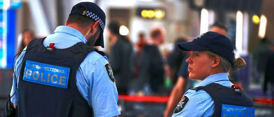 Australian Federal Police officers stand near the check-in counters at the Sydney Airport Domestic terminal in Australia