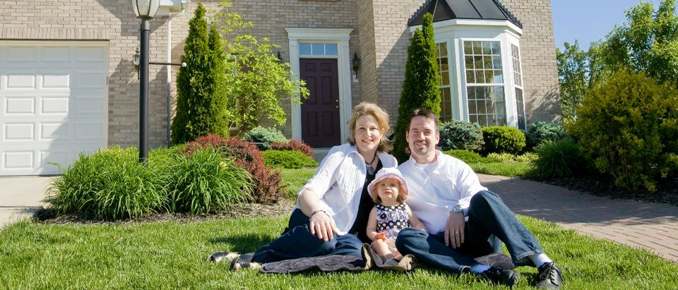 family in yard Shutterstock/sonya etchison