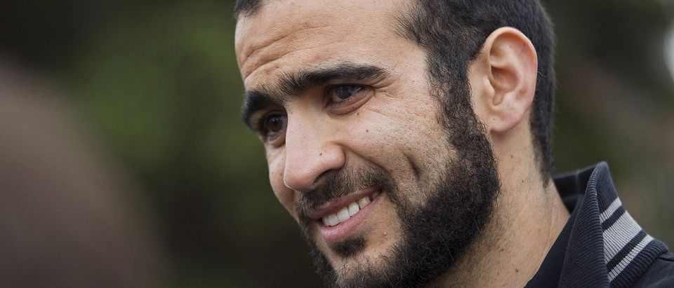 Khadr listens to a question during a news conference after being released on bail in Edmonton