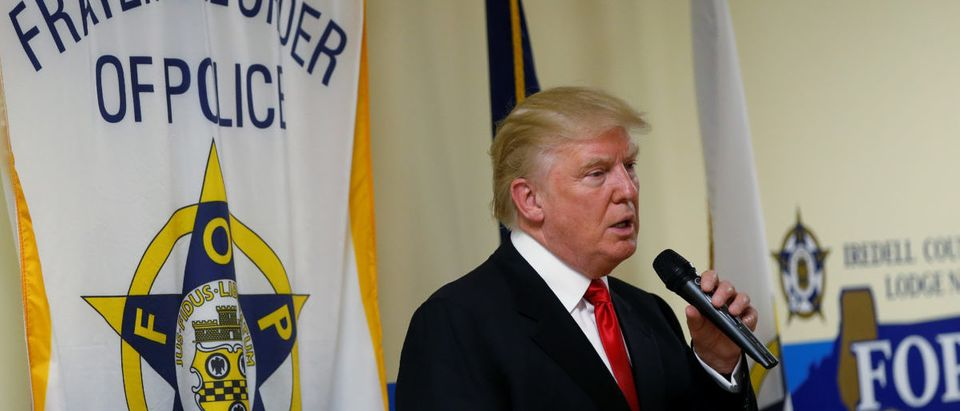 Republican presidential candidate Donald Trump speaks to police gathered at Fraternal Order of Police lodge during a campaign event in Statesville, North Carolina, U.S., August 18, 2016. REUTERS/Carlo Allegri - RTX2LVF2