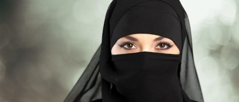 A Middle Eastern woman wears a traditional Muslim niqab. Source: Billion Phots/Shutterstock