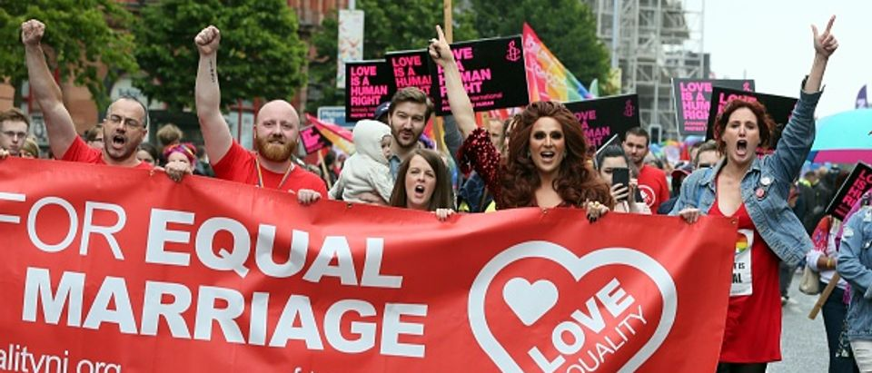 Gay rights campaigners take part in a march through Belfast on July 1, 2017 to protest against the ban on same-sex marriage. / AFP PHOTO / Paul FAITH (Photo credit should read PAUL FAITH/AFP/Getty Images)