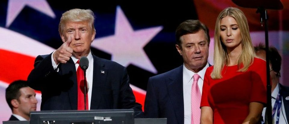 FILE PHOTO: Republican presidential nominee Donald Trump gives a thumbs up as his campaign manager Paul Manafort and daughter Ivanka look on during Trump's walk through at the Republican National Convention in Cleveland