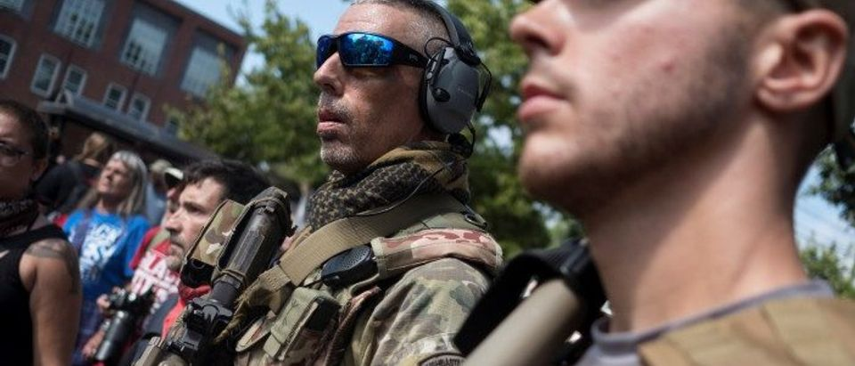 Member of a white supremacists militia stands near a rally in Charlottesville