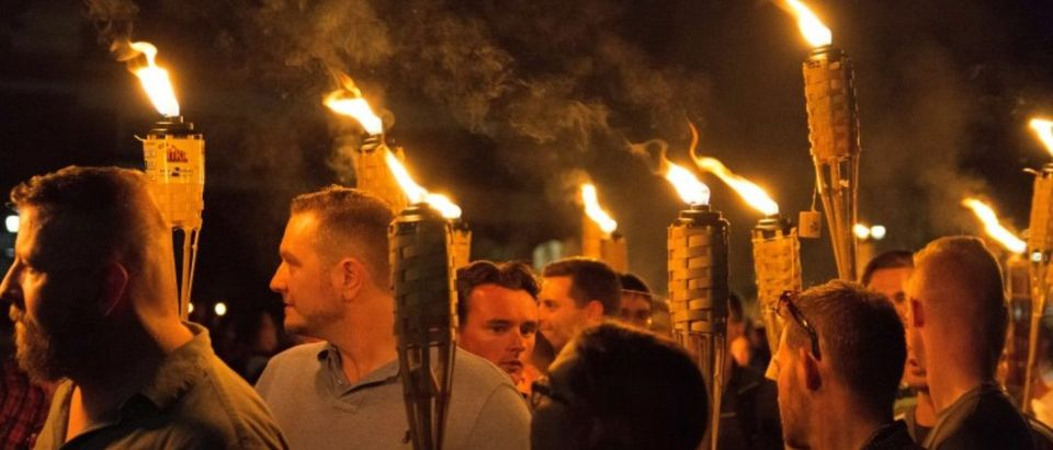 White nationalists carry torches on the grounds of the University of Virginia, on the eve of a planned Unite The Right rally in Charlottesville. Alejandro Alvarez/News2Share via REUTERS