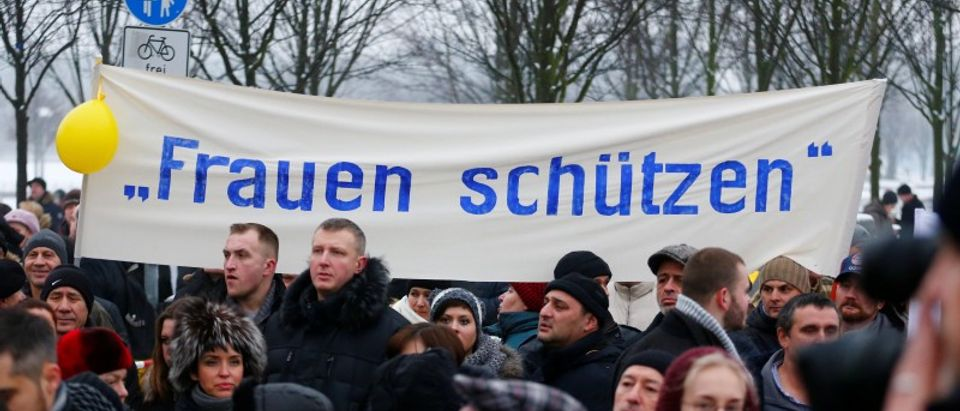 FILE PHOTO: Activists and supporters of the 'International Convention of German Russians' protest against sexual harassment by migrants in front of the Chancellery in Berlin