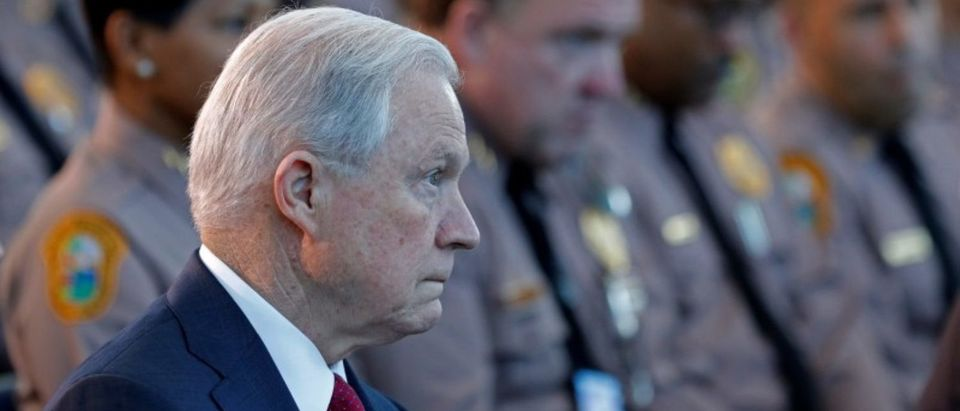 U.S. Attorney General Jeff Sessions (C) sits with guests before speaking on the growing trend of violent crime in sanctuary cities during an event on the Port of Miami in Miami