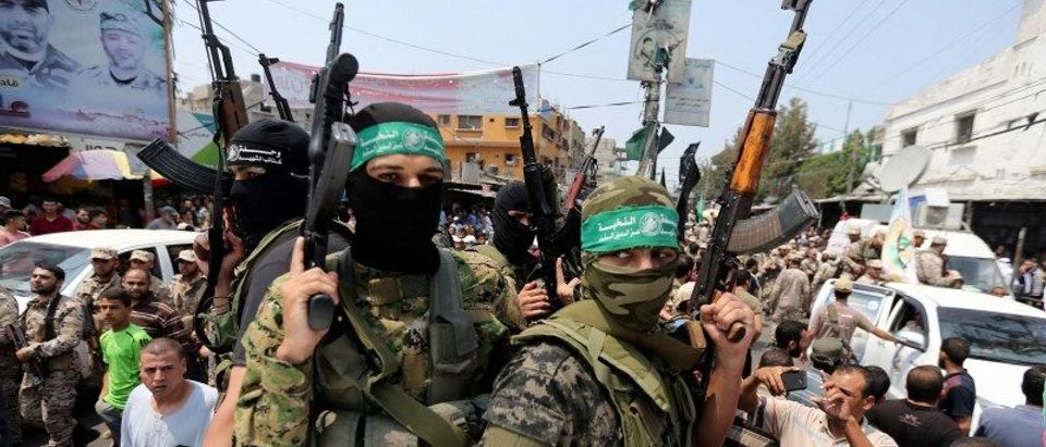 Palestinian Hamas militants attend the funeral of their comrade in Rafah, in the southern Gaza Strip