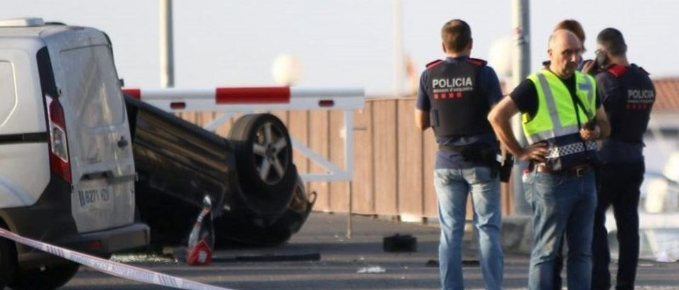 Police investigate at the scene of an attack in Cambrils, south of Barcelona