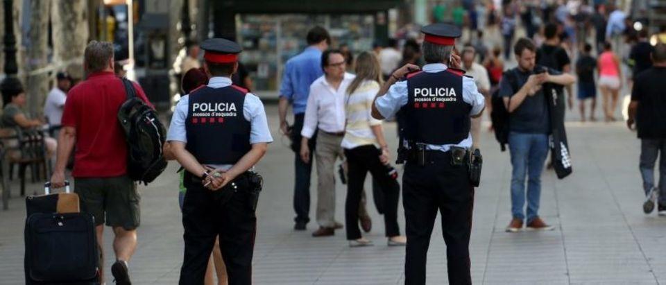 Catalan Mossos d'esquadra officers patrol at Las Ramblas street where a van crashed into pedestrians in Barcelona