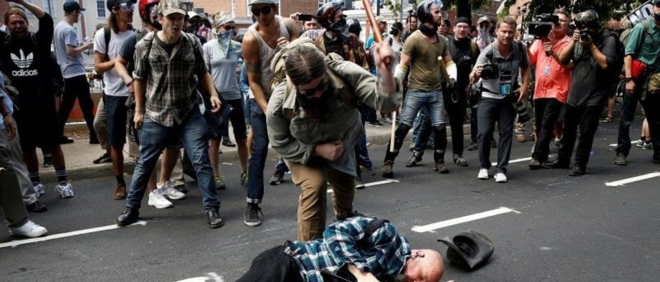 FILE PHOTO: Counter demonstrators attack a white nationalist during a rally in Charlottesville, Virginia, U.S., August 12, 2017. REUTERS/Joshua Roberts/File Photo