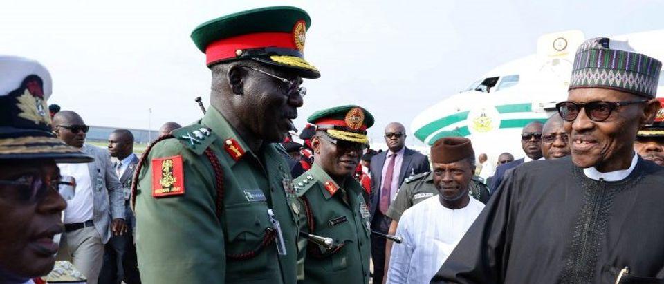 Nigeria's President Muhammadu Buhari is received by Chief of Army Staff Lieutenant General Tukur Yusufu Buratai at Nnamdi Azikiwe airport in Abuja