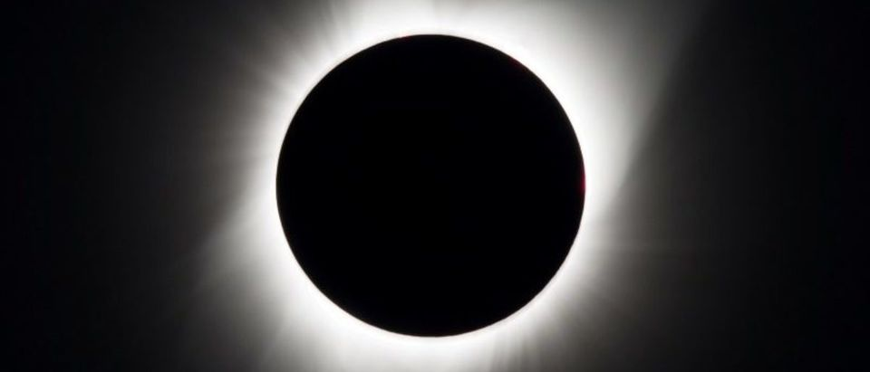 A total solar eclipse is seen above Madras