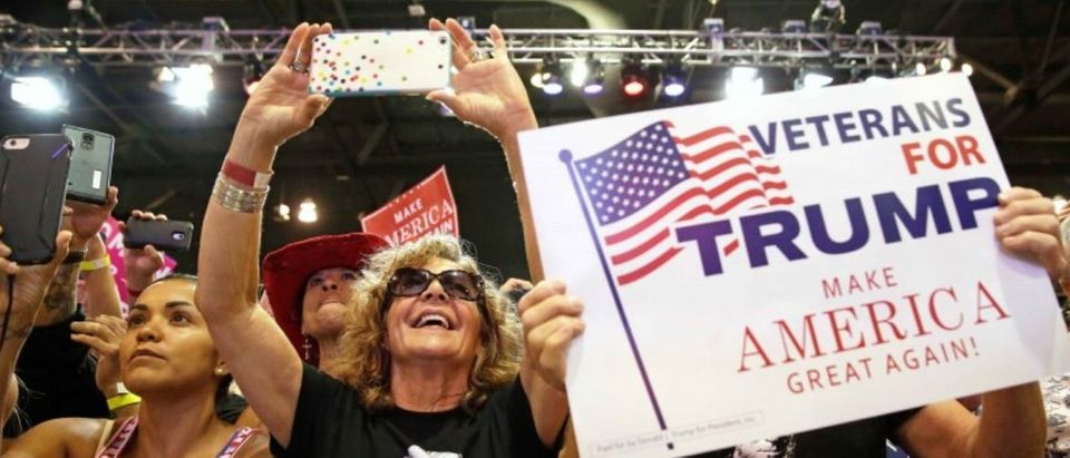 Supporters of U.S. President Donald Trump cheer him at a campaign rally in Phoenix, Arizona