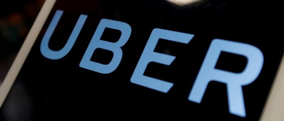 FILE PHOTO: The logo of Uber is seen on an iPad, during a news conference to announce Uber resumes ride-hailing service, in Taipei, Taiwan April 13, 2017. REUTERS/Tyrone Siu/File Photo
