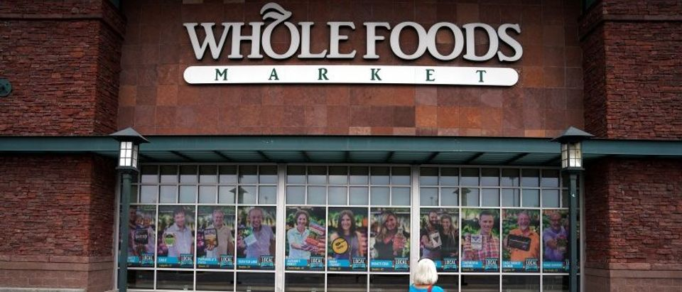 A customer enters the Whole Foods Market in Superior