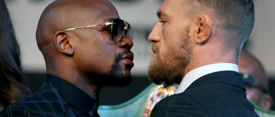 Undefeated boxer Floyd Mayweather Jr. of the U.S. and UFC lightweight champion Conor McGregor of Ireland face off during a news conference in Las Vegas. (REUTERS/Las Vegas Sun/Steve Marcus)