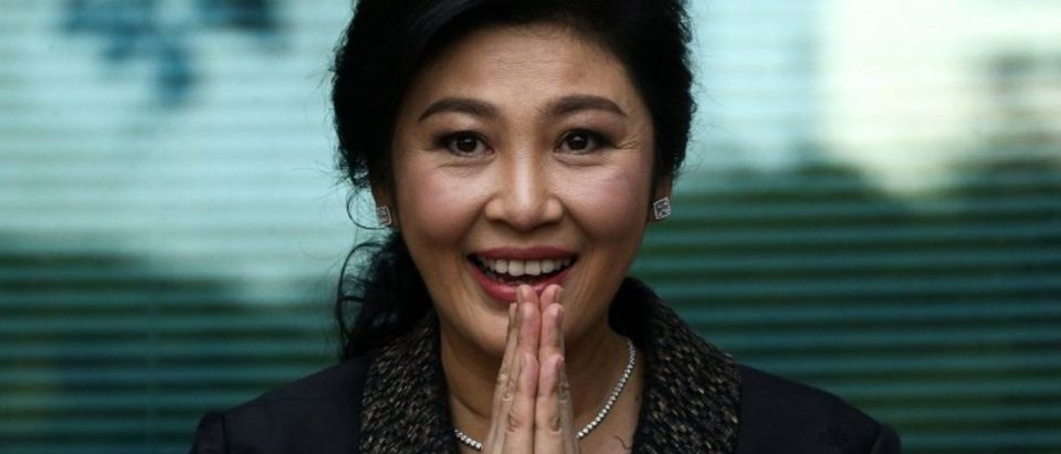 FILE PHOTO: Ousted former Thai prime minister Yingluck Shinawatra greets supporters as she arrives at the Supreme Court in Bangkok