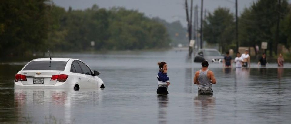 Residents wade through flood waters from Tropical Storm Harvey in Houston, Texas