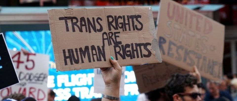 FILE PHOTO: People protest Trump's announcement that he plans to reinstate a ban on transgender individuals from serving in any capacity in the U.S. military, in Times Square