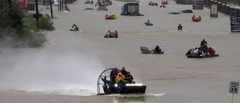 Residents use boats to evacuate flood waters from Tropical Storm Harvey along Tidwell Road east Houston, Texas