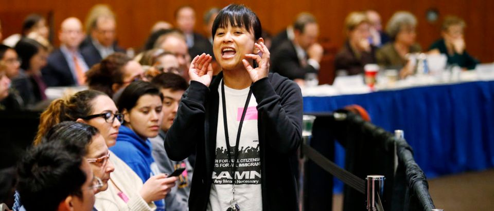 Felarca from By Any Means Necessary yells during the voting portion of a University of California Regents meeting in San Francisco