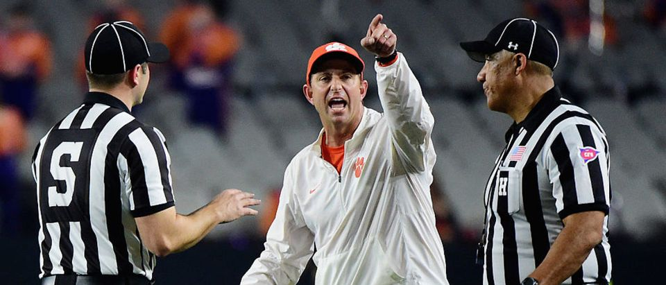 Head coach Dabo Swinney of the Clemson Tigers argues a call with the referees against the Alabama Crimson Tide in the first half during the 2016 College Football Playoff National Championship Game at University of Phoenix Stadium on January 11, 2016 in Glendale, Arizona. (Photo by Harry How/Getty Images)