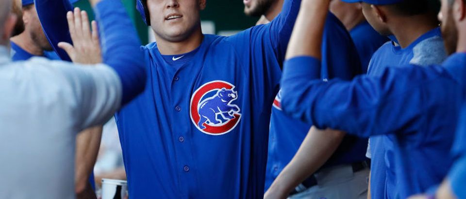Anthony Rizzo is congratulated by teammates after scoring in the first inning of the Chicago Cubs against the Cincinnati Reds at Great American Ball Park on August 23, 2017 in Cincinnati, Ohio. (Photo by Andy Lyons/Getty Images)