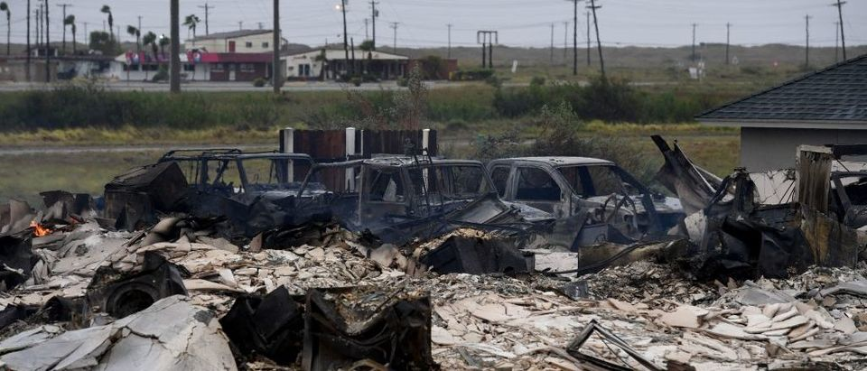 A burnt out house and cars that caught fire are seen after Hurricane Harvey hit Corpus Christi, Texas on August 26, 2017. Hurricane Harvey slammed into the Texas coast late Friday, unleashing torrents of rain and packing powerful winds, the first major storm to hit the US mainland in 12 years. MARK RALSTON/AFP/Getty Images