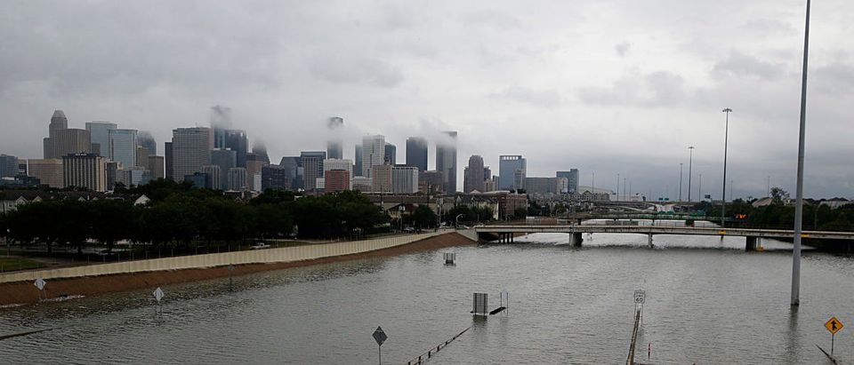 The downtown Houston skyline and flooded highway 288 are seen August 27, 2017 as the city battles with tropical storm Harvey and resulting floods. (THOMAS B. SHEA/AFP/Getty Images)