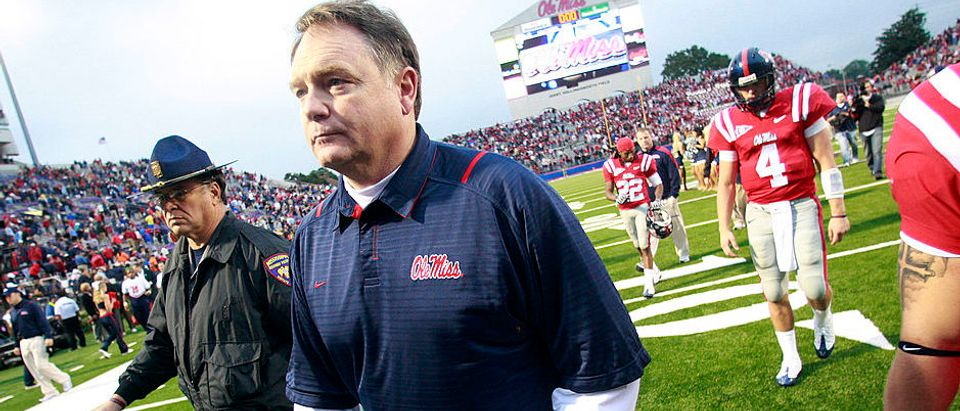 Coach Houston Nutt of the Mississippi Rebels walks off the field followed by quarterback Jevan Snead #4 after losing to the Alabama Crimson Tide 22-3 in their college football game at Vaught-Hemingway Stadium in October 2009 in Oxford, Mississippi. (Photo by Dave Martin/Getty Images)