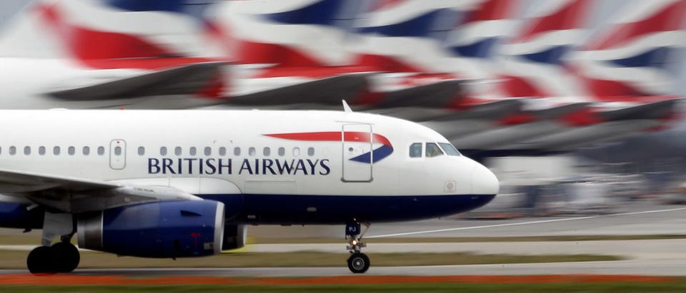 British Airways plane lands at Heathrow Airport.