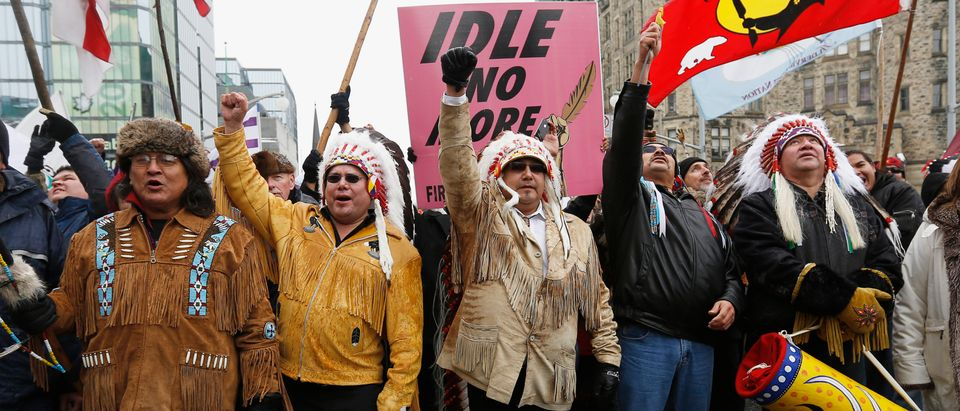 First Nations protesters march towards Parliament Hill before meeting between chiefs and Canada's PM Harper in Ottawa