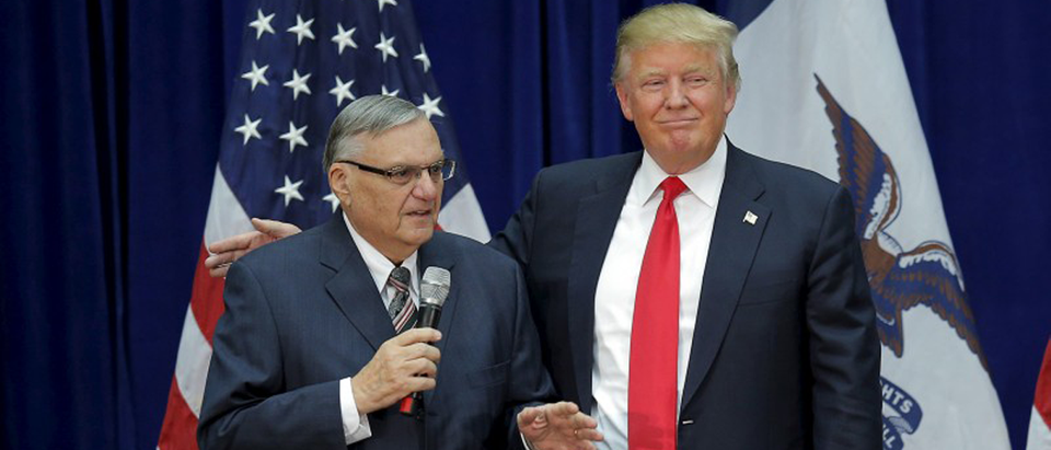 U.S. Republican presidential candidate Donald Trump is joined onstage by Maricopa County Sheriff Joe Arpaio (L) at a campaign rally in Marshalltown, Iowa January 26, 2016, after Arpaio endorsed Trump's. REUTERS/Brian Snyder
