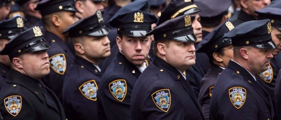 New York Police Department (NYPD) officials attend the funeral of Detective and Air National Guard Sergeant Joseph Lemm at St. Patrick's Cathedral on December 30, 2015 in New York City (Andrew Burton/Getty Images)
