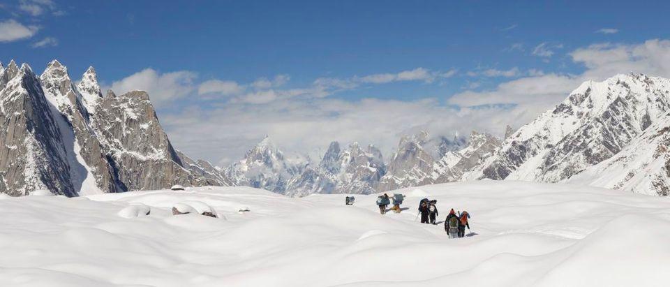 Trekkers and porters hike down the Baltoro glacier in the Karakoram mountain range in Pakistan
