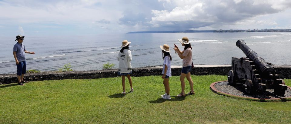 South Korean tourists stroll outside the Governor's Complex on the island of Guam