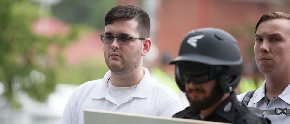 James Alex Fields Jr. is seen participating in Unite The RIght rally before his arrest in Charlottesville