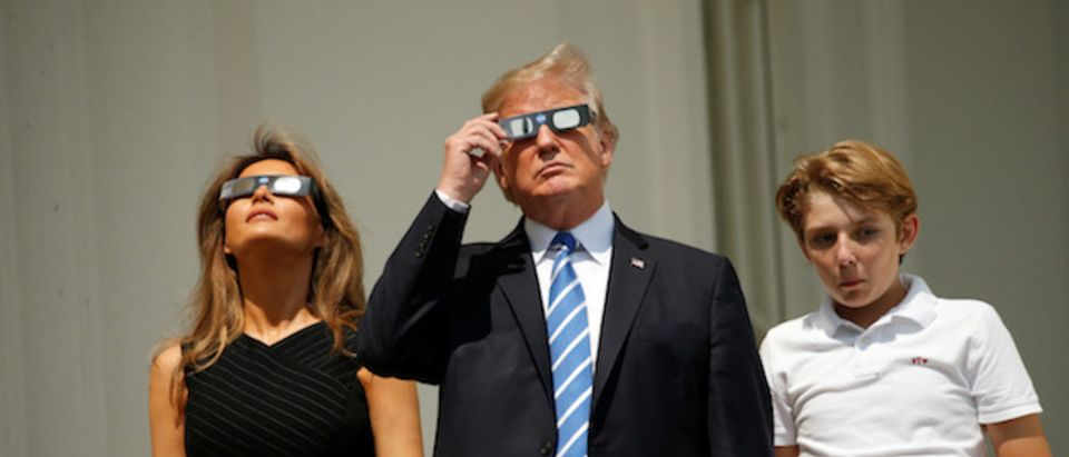 U.S. President Trump watches the solar eclipse with first Lady Melania Trump and son Barron from the Truman Balcony at the White House in Washington