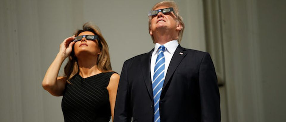U.S. President Trump watches the solar eclipse with first Lady Melania Trump from the Truman Balcony at the White House in Washington