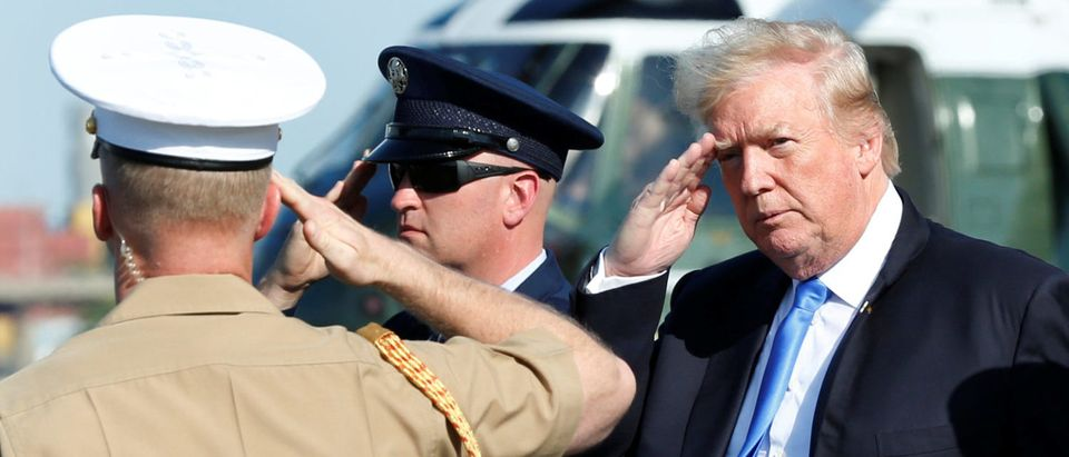 U.S. President Donald Trump salutes as he arrives at Newark International airport in Newark, NJ U.S., to spend a weekend at Trump National Golf Club in Bedminister, New Jersey, June 9, 2017. (Photo: REUTERS/Yuri Gripas)