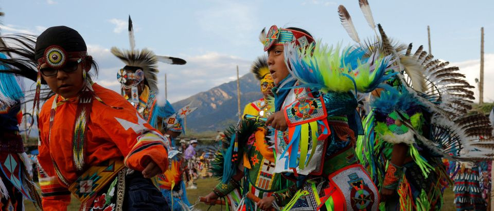 Dancers take part in the evening Grand Entry on the second day of the 32nd Annual Taos Pueblo Pow Wow in Taos