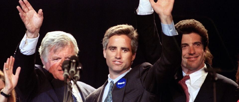 US Senator Edward Kennedy (L) is joined onstage by his nephew Max Kennedy (C) , son of Robert F. Ken..
