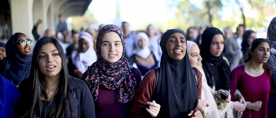 Students chant while marching at a rally against Islamophobia at San Diego State University in San Diego