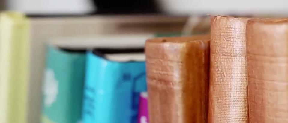 Stack of books. (Youtube screenshot/HGTV Handmade)