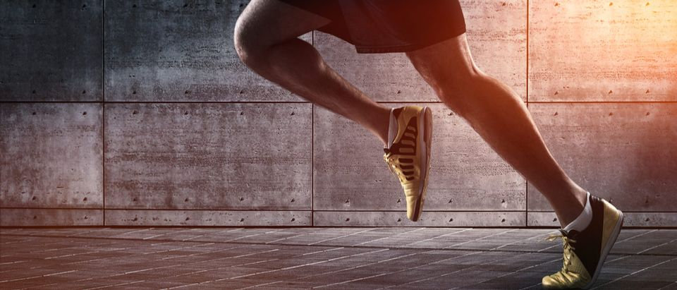 Shutterstock/ Sport background, close up of urban runner's legs run on the street with copy space