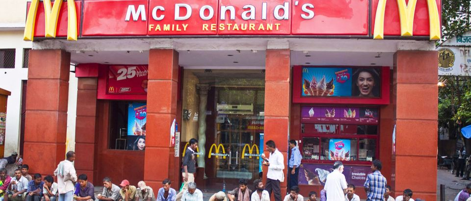 Shutterstock/ DELHI - AUGUST 3: People sitting in front of McDonald's on August 3, 2011 in Delhi, India. It's the only country in the world that does not offer beef on its menu. indiamcdonaldarchitectureburgerbusycrowddelhieatexteriorfacadefastfastfoodfoodindianpeopleredrestaurantroadsignsittingstreettaketakeawayShow more
