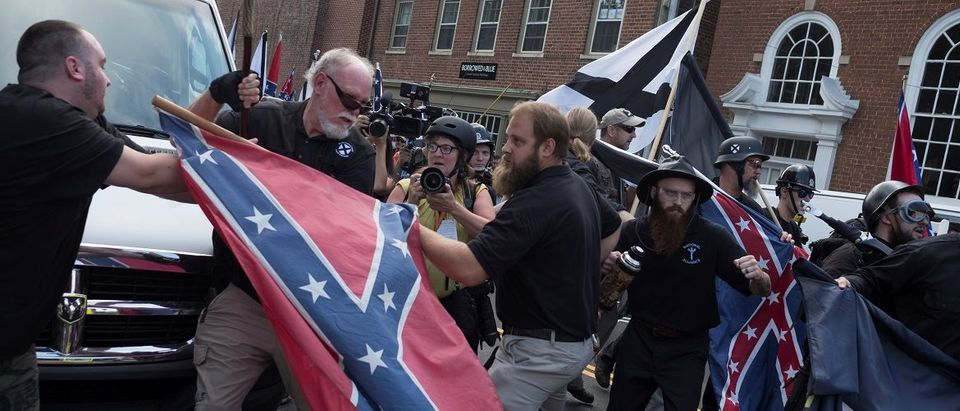 People struggle with a Confederate flag as a crowd of white nationalists are met by a group of counter-protesters in Charlottesville