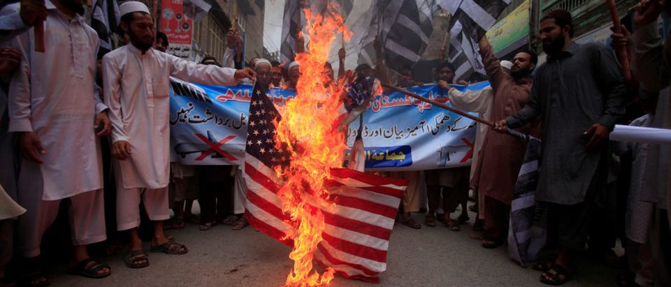 Supporters of terror group Jamaat-ud-Dawa burn the American flag in protest in Peshawar, Pakistan, May 27, 2016. (Photo: REUTERS/Fayaz Aziz)